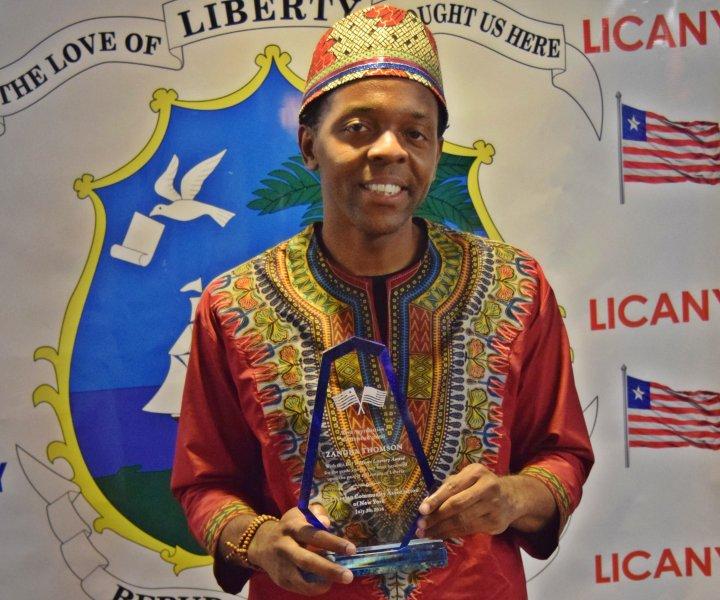 Zangba Thomson winning Award +photo by Denzel Mooney